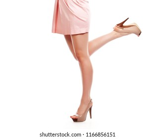 Beautiful woman legs isolated over white background