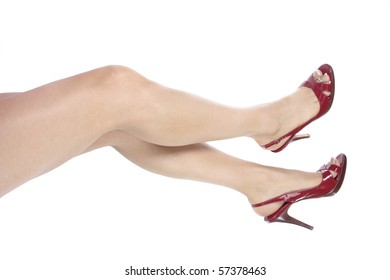 Beautiful woman legs and red heel shoes over white
