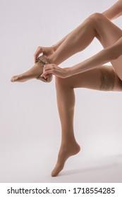 beautiful woman legs in tights - Shutterstock ID 1718554285