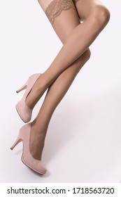 beautiful woman legs in tights and shoes