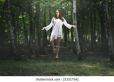 Beautiful woman levitation in the forest . Fantasy and surreal