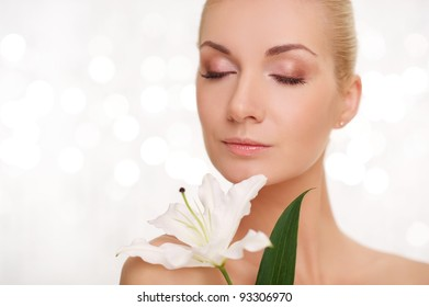 Beautiful woman with lilly flower portrait.