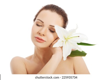 Beautiful woman with a lily flower