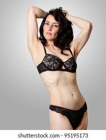 A beautiful woman in lingerie posing in studio