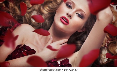 beautiful woman in lingerie with roses