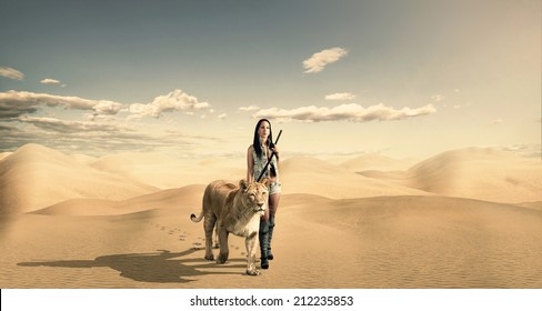 Beautiful woman with a lion in the desert