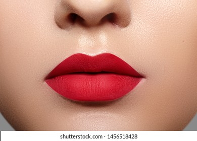 Beautiful Woman Lips with Fashion Mat Lipstick Makeup. Glamourous Red Lip Make-Up Concept. Beauty Visage. Valentine Day Style