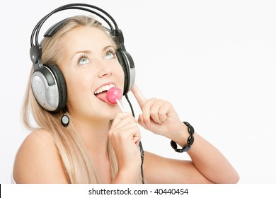 Beautiful Woman Listening Music and dancing, on white background