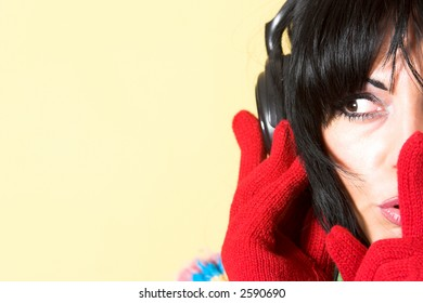 beautiful woman listening music in headphones gestures for silence, shhh
