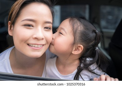 Beautiful woman with little child driving in car.Family safety transport road trip and happy people concept.