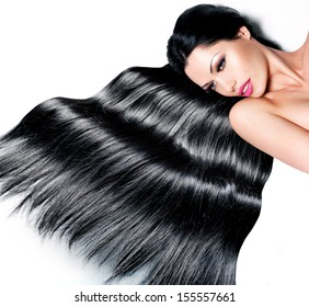Beautiful woman with long black hair. Fashion model posing at studio.