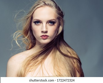 Beautiful woman long blond hair natural beauty make up healthy skin and hair