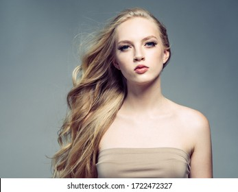 Beautiful woman long blond hair natural beauty make up healthy skin and hair
