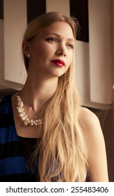 Beautiful woman with long blond hari and red lipstick