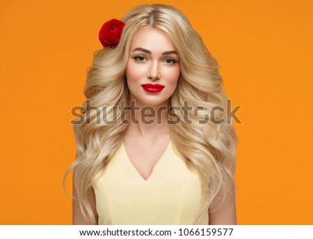 Beautiful woman with long blonde hair and red lips, colorful emotional female portrait with beauty