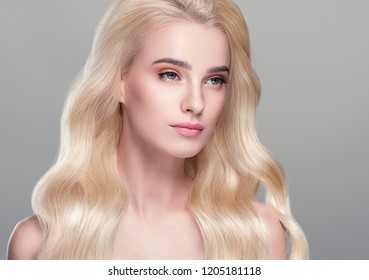 Beautiful woman with long blonde healthy beauty hair and healthy skin cosmetic shampoo concept female model portrait