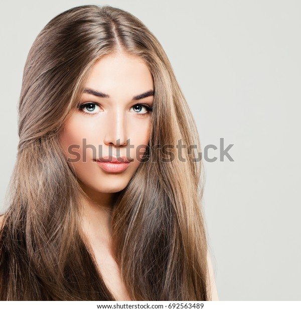 Beautiful Woman with Long Brown Hair. Makeup, Hairstyle and Cute Face. Fashion Portrait