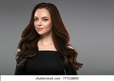 Beautiful Woman long btunette hair. Beautiful Spa model Girl with Perfect Fresh Clean Skin. Brunette woman smiling on black background. Beauy hairstyle