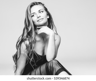 Beautiful woman long curly hair beauty black and white portrait