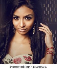 Beautiful woman with long dark hair.