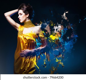 beautiful woman in long dress with jewelry and splatter