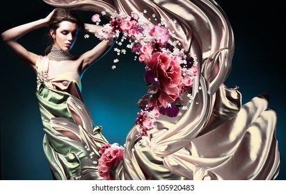beautiful woman in long fairy dress and flowers