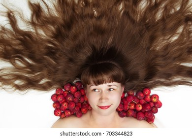 beautiful woman with long hair and apples top view