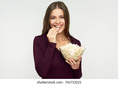 Beautiful woman with long hair eating pop corn. Isolated studio portrait.