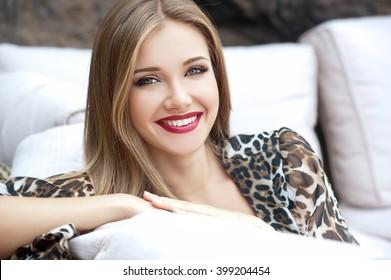 Beautiful woman with long hair. Smiling girl. Young pretty girl with beautiful long hairs and red lips