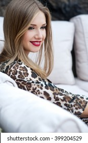 Beautiful woman with long hair. Smiling girl. Young pretty woman with beautiful long hairs and red lips