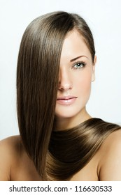beautiful woman with long natural healthy hair , brown hairstyle