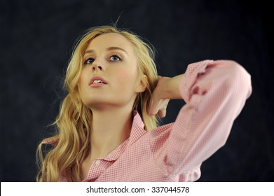 Beautiful woman with long straight blond hair. Fashion model look up.