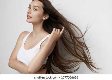 Beautiful Woman With Long Straight Hair. Smiling Girl With Natural Face Makeup And Healthy Long Brown Hair. High Quality