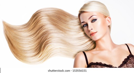 Beautiful woman with long white hair. Closeup portrait of a fashion model over white background