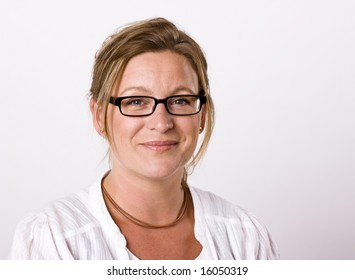 Beautiful woman looking into camera with a friendly smile