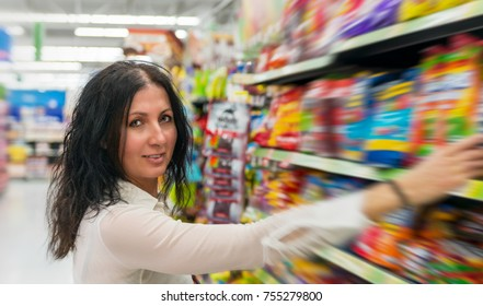 Beautiful woman looking for items at supermarket.