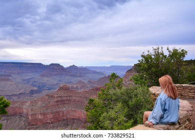 Beautiful woman looking out at the Grand Canyon from the South Rim, Usa.