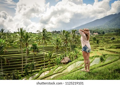 Beautiful  woman looking at beautiful tegallalang rice terrace in Bali, Indonesia