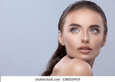 beautiful woman looking up, pretty female closeup, brunette looks up, caucasian white copyspace