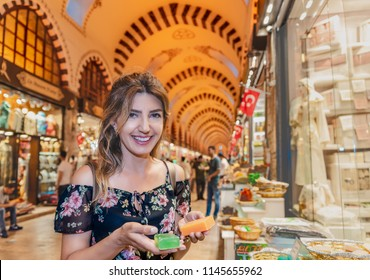 Beautiful woman looks traditional soaps made from natural herbs and sold in Egypt Bazaar in Eminonu,Istanbul,Turkey