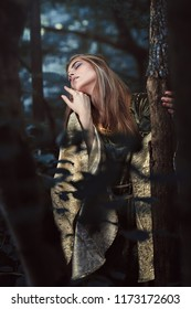 Beautiful woman lost in magical woods . Fantasy and surreal