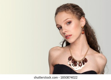 Beautiful woman with luxury jewelry. Beads earrings and necklace.