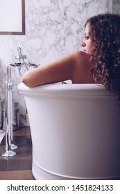 Beautiful woman lying down in the bathtube and relaxation at home, Concept happy and peaceful day.