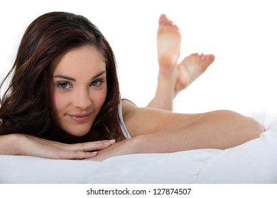 beautiful woman lying in her bed