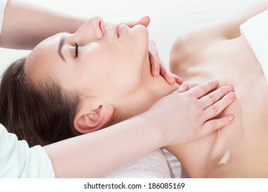 Beautiful woman lying on back and relaxing at spa