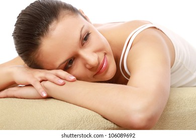 A beautiful woman lying on the bed , isolated on white background