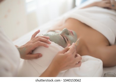 Beautiful woman lying on spa mask face with treatment spa, relax and healthy