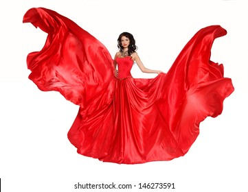 Beautiful woman in magnificent red dress isolated on white background. Studio photo. Fashion.