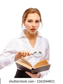 Beautiful woman with magnifying glass and books, isolated on white background.