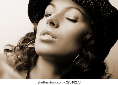 Beautiful woman. Makeup & Fashion (sepia toned)